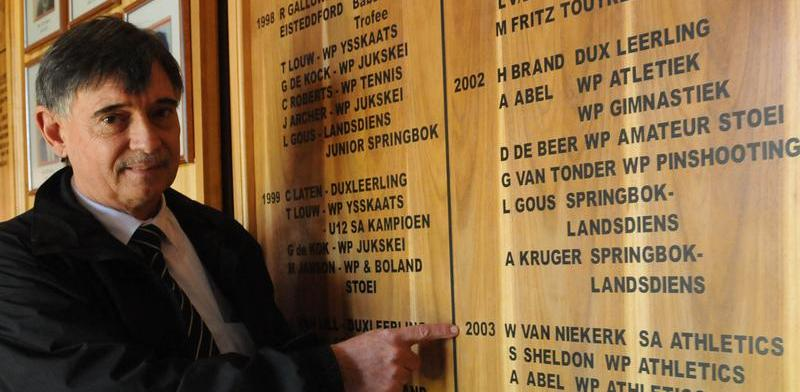 Cape Town 15/08/2016 Principal Danie Bester of Bellville Primary in Bellville points to the name of Wayde as a sports achiever pix Patrick story Saafia